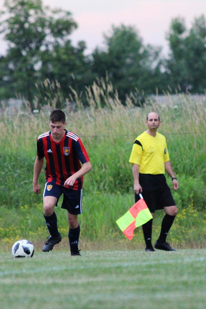 linesman officiating at a competitive game