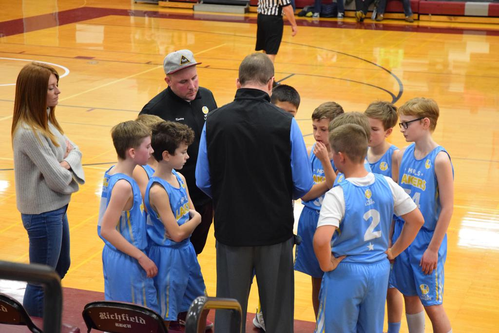 Minneapolis Lakers Boys 4th Grade Blue huddle up during a time out during play at the MYAS Supersaver in Richfield, MN