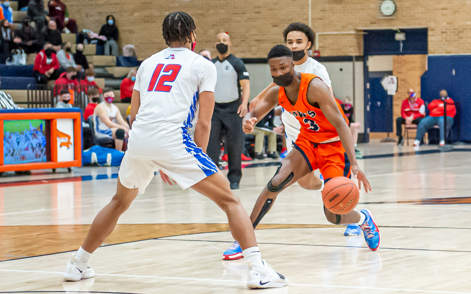 Robbinsdale Cooper's Prince Appiah (3) drives to the basket Friday night. Appiah had 17 points in a 84-57 victory over Robbinsdale Armstrong in the Class 4A, Section 6 semifinal. Photo by Earl J. Ebensteiner, SportsEngine
