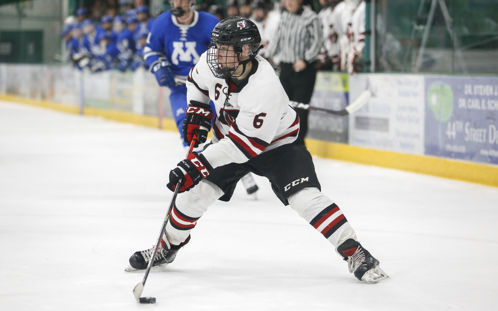Eden Prairie's Ben Steeves (6) looks for a passing lane against Minnetonka Saturday afternoon. Steeves had two goals and an assist in the Eagles 6-1 victory over the Skippers at Braemar Arena. Photo by Jeff Lawler, SportsEngine