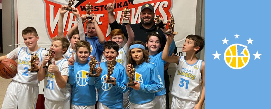 Minneapolis Lakers Youth Basketball Program Boys 5th Grade Blue pose with their Trophies after becoming the Champions at the Westonka White Hawk Classic tournament in Mound, MN