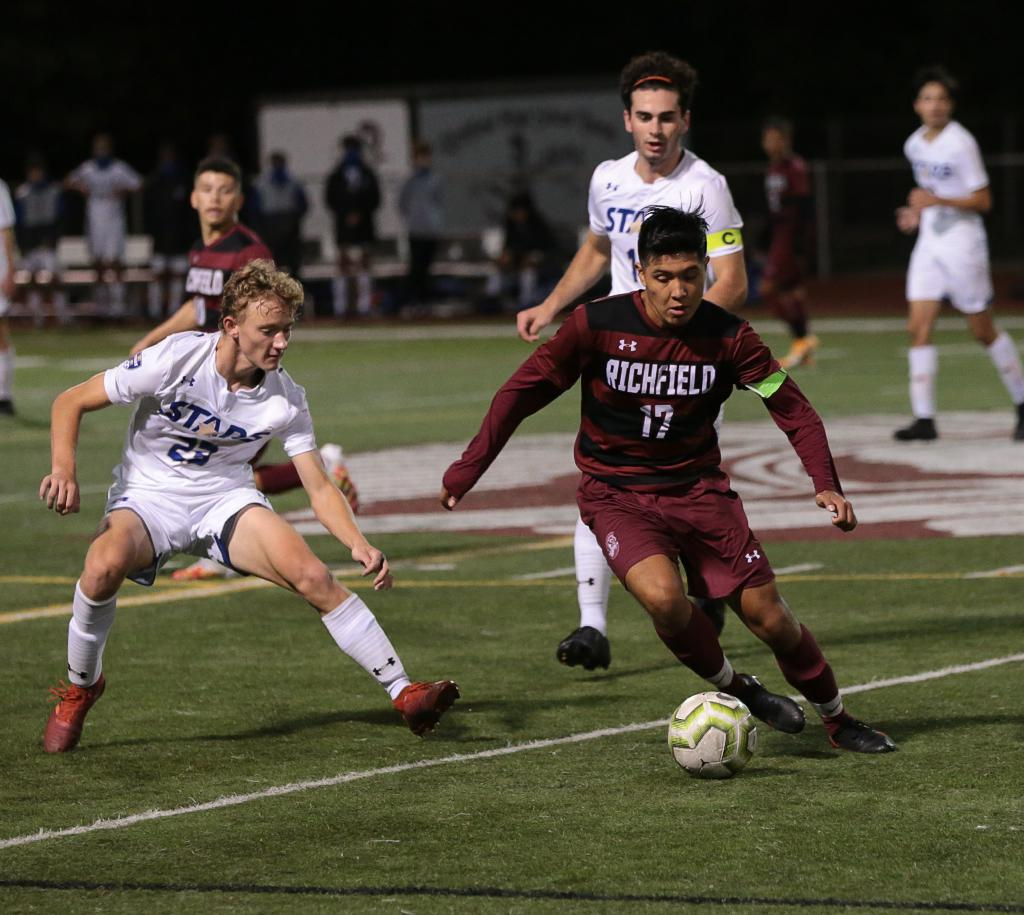 Richfield earns the Tri-Metro Conference title with a 1-0 victory over the defending Class 1A champion Holy Angels.  Miguel Leon Alvarado (17) scored the lone goal on a penalty kick late in the second half. Photo by Cheryl A. Myers, SportsEngine