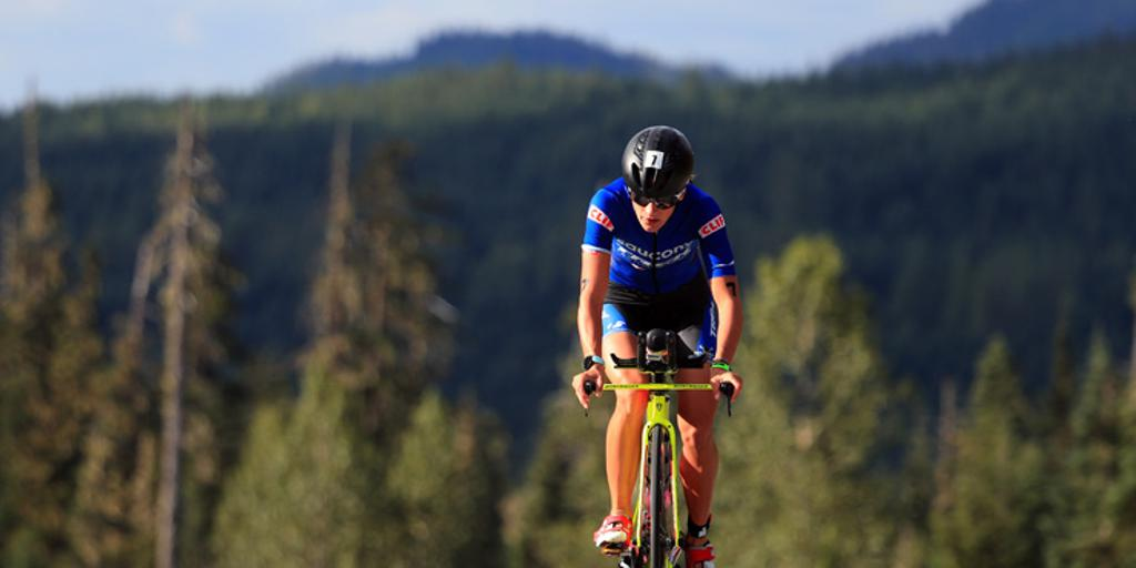 Triathlete biking in Canada