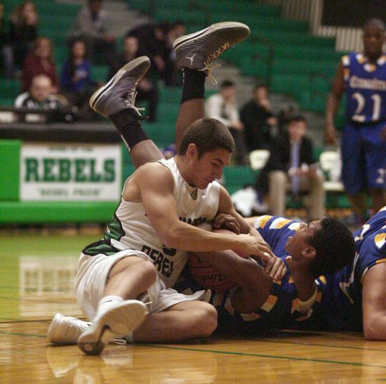 Ridgewood's Adam Yaghmour (let) fights for the loose ball against Kennedy's Ricky Ellis