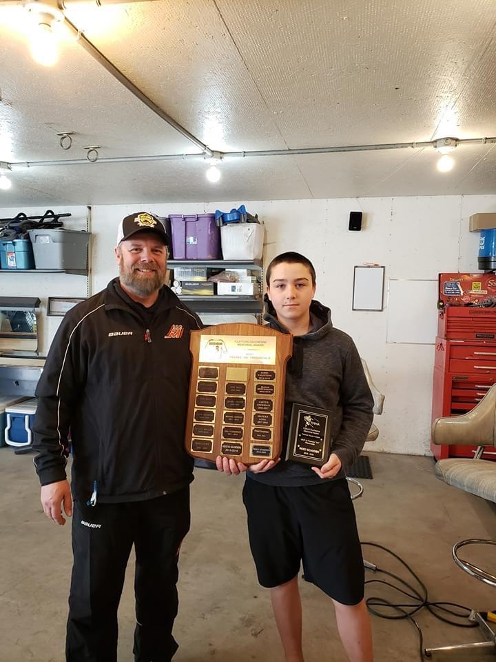 "Mathew Steeves - TMHA President presenting Reed Scaddan with the Clifford Duchesne Memorial Award - MVP at Peewee ""AA"" Provincials."