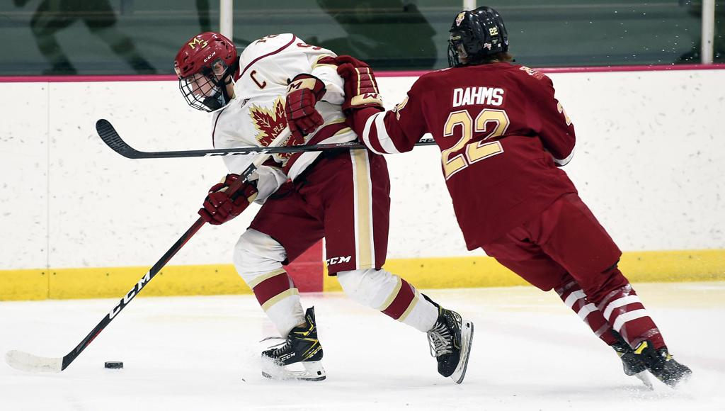 Maple Grove's Kyle Kukkonen, left, works past Ashton Dahms of Lakeville South during Tuesday's game at the Maple Grove Community Center. Photo by Loren Nelson, SportsEngine