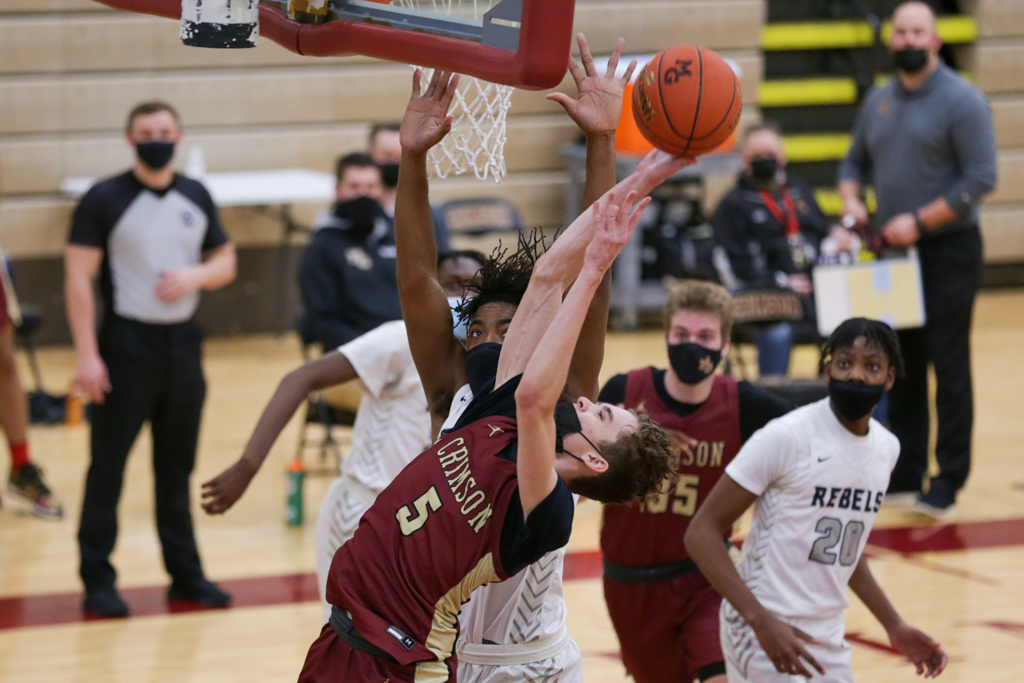 Maple Grove's Morgan Moore (5) goes up for a rebound against Champlin Park Friday night. Moore had 16 points in the Crimson's 57-50 loss to the Rebels. Photo by Jeff Lawler, SportsEngine