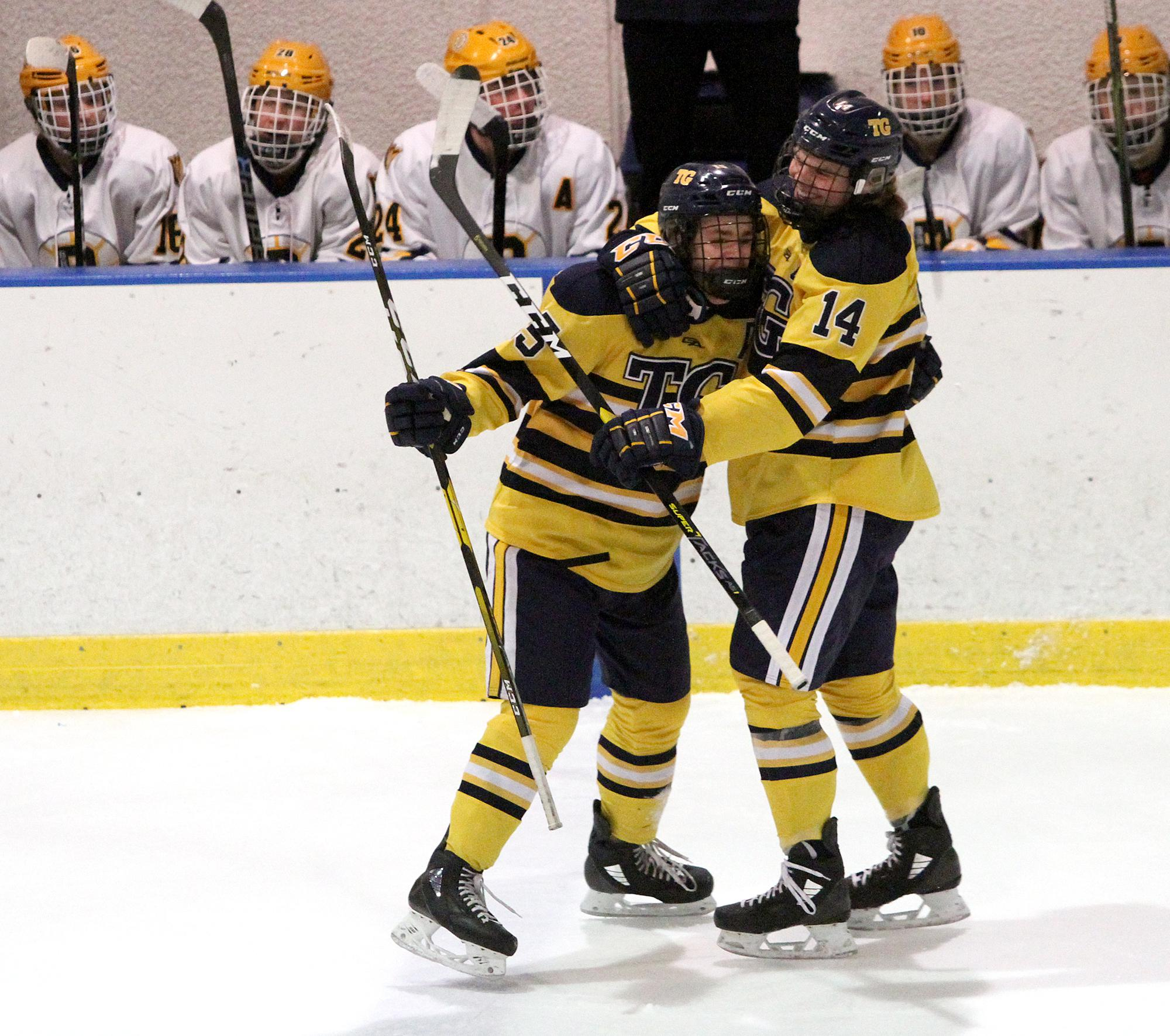 Totino-Grace seniors Caleb Meehan (15) and Jake Wacek (14) celebrate Meehan's second goal of the first period Saturday in Golden Valley. Photo by Drew Herron, SportsEngine