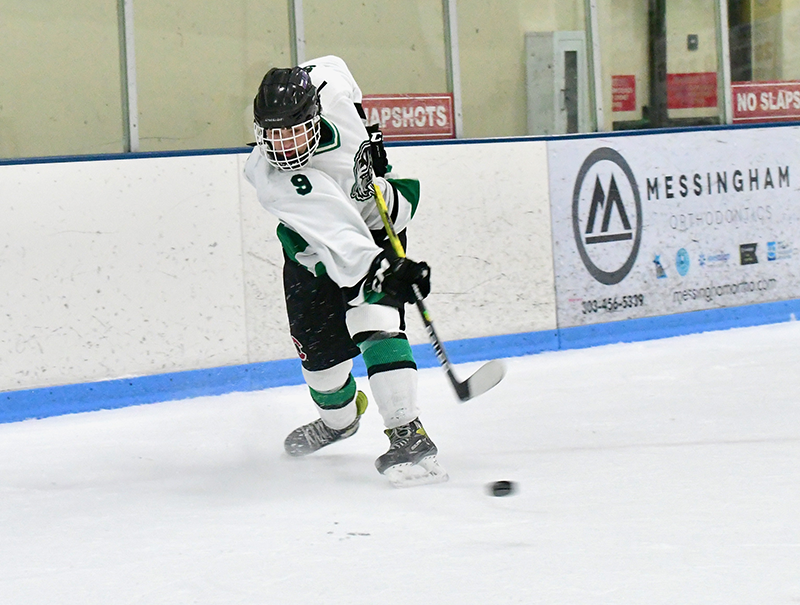 Nolan Devine (9) of Fossil Ridge unloads the puck during the Sabercats' 4-2 defeat to Ralston Valley in Arvada on Saturday. Devine had a goal and an assist in the loss. Photo by Steven Robinson, SportsEngine