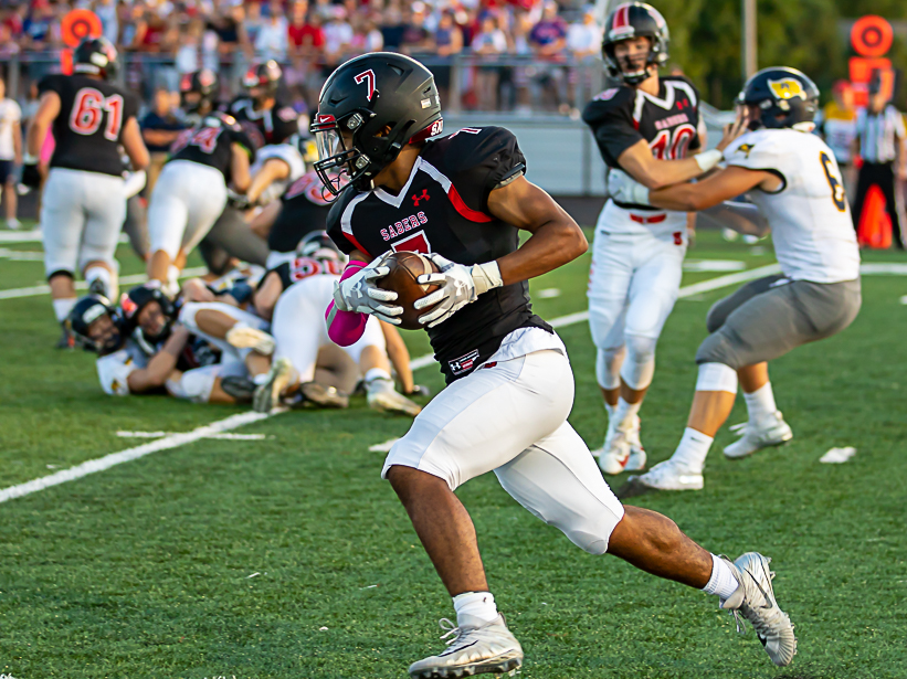 Shakopee senior running back Donovan Monroe scored the Sabers' first touchdown against visiting Prior Lake Friday night in Shakopee. Photo by Gary Mukai, SportsEngine