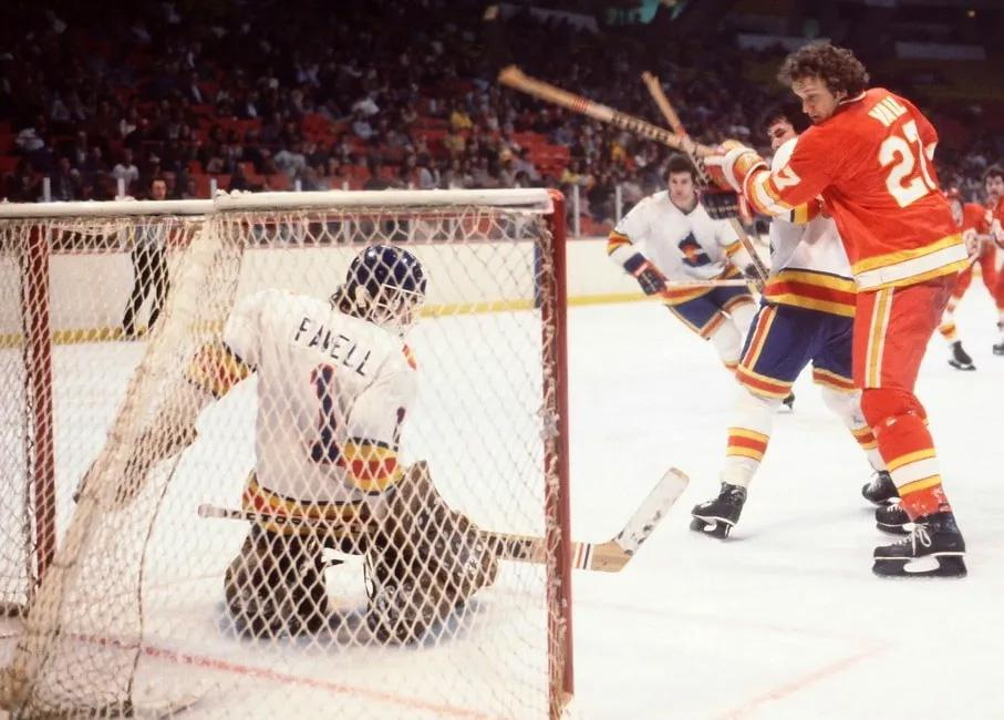 Rockies goalie Doug Favell attempts a save in a matchup against the Atlanta Flames. Favell played three seasons in a Rockies sweater. Public domain photo