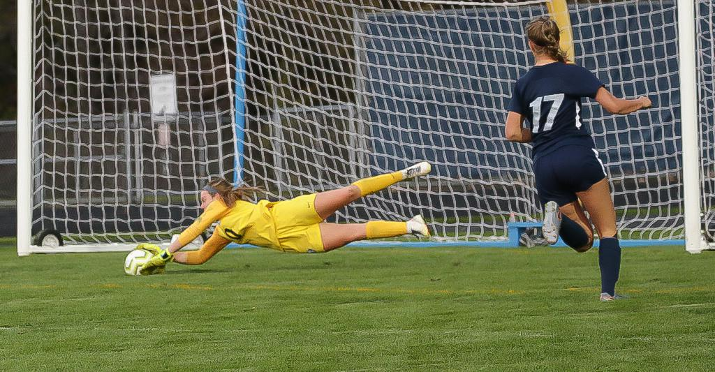 Goalkeeper Tess Enlow (0) makes a diving save in the second half for the Bengals. Enlow's strong play helped Blaine finish a 4-4 tie against Northwest Suburban Conference foe Champlin Park. Photo by Cheryl A. Myers, SportsEngine