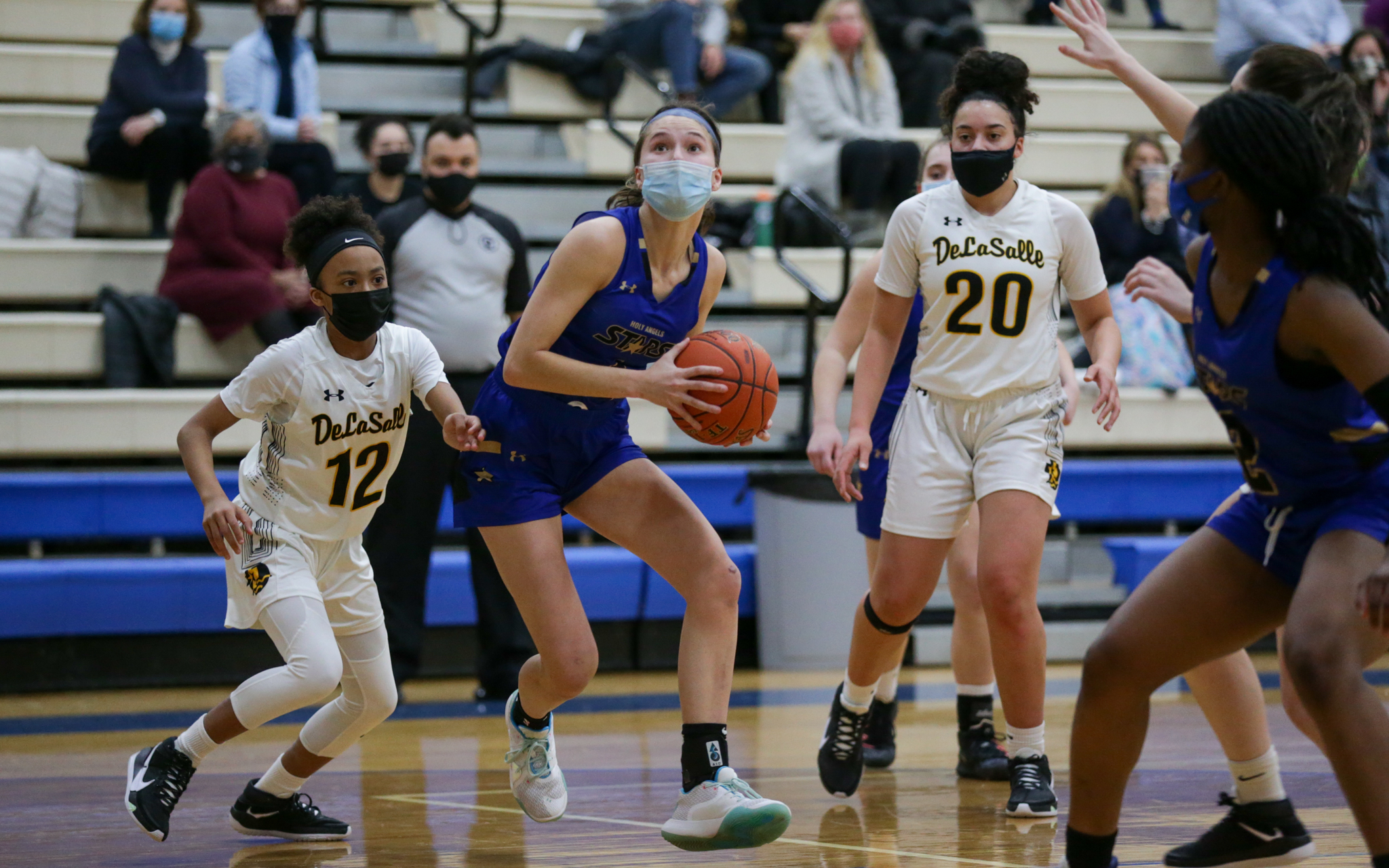 Holy Angels' Francesca Vascellaro (1) drives toward the basket during the first half of Friday night's game against DeLaSalle. Vascellaro had a game-high 24 points in the Stars' 96-69 victory over the Islanders. Photo by Jeff Lawler, SportsEngine