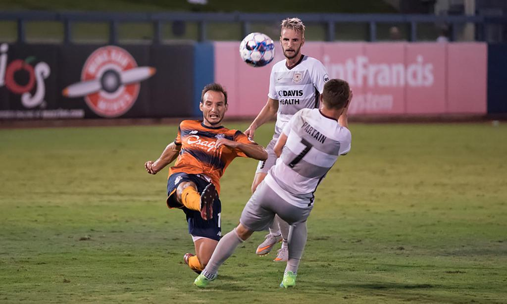 Ivan Mirkovic fights for possession during Wednesday's match at ONEOK Field.  (Tim Campbell)
