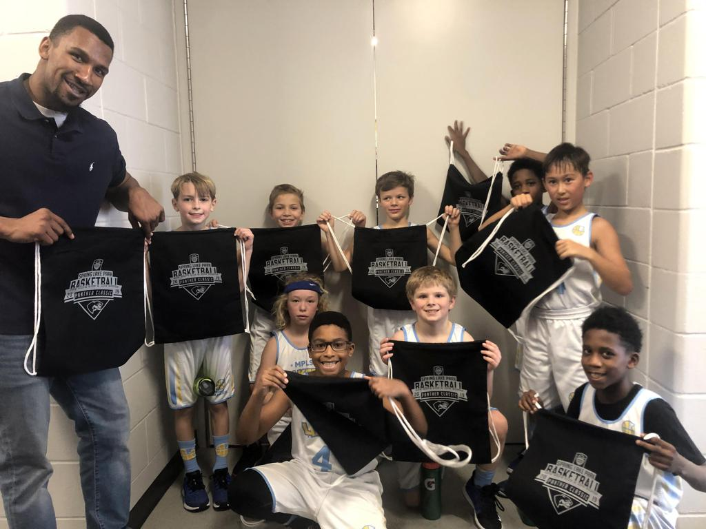 Minneapolis Lakers Boys 4th Grade White pose with their Draw-String Back packs after earning 3rd place at the Spring Lake Park Panther Classic tournament in Spring Lake Park, MN