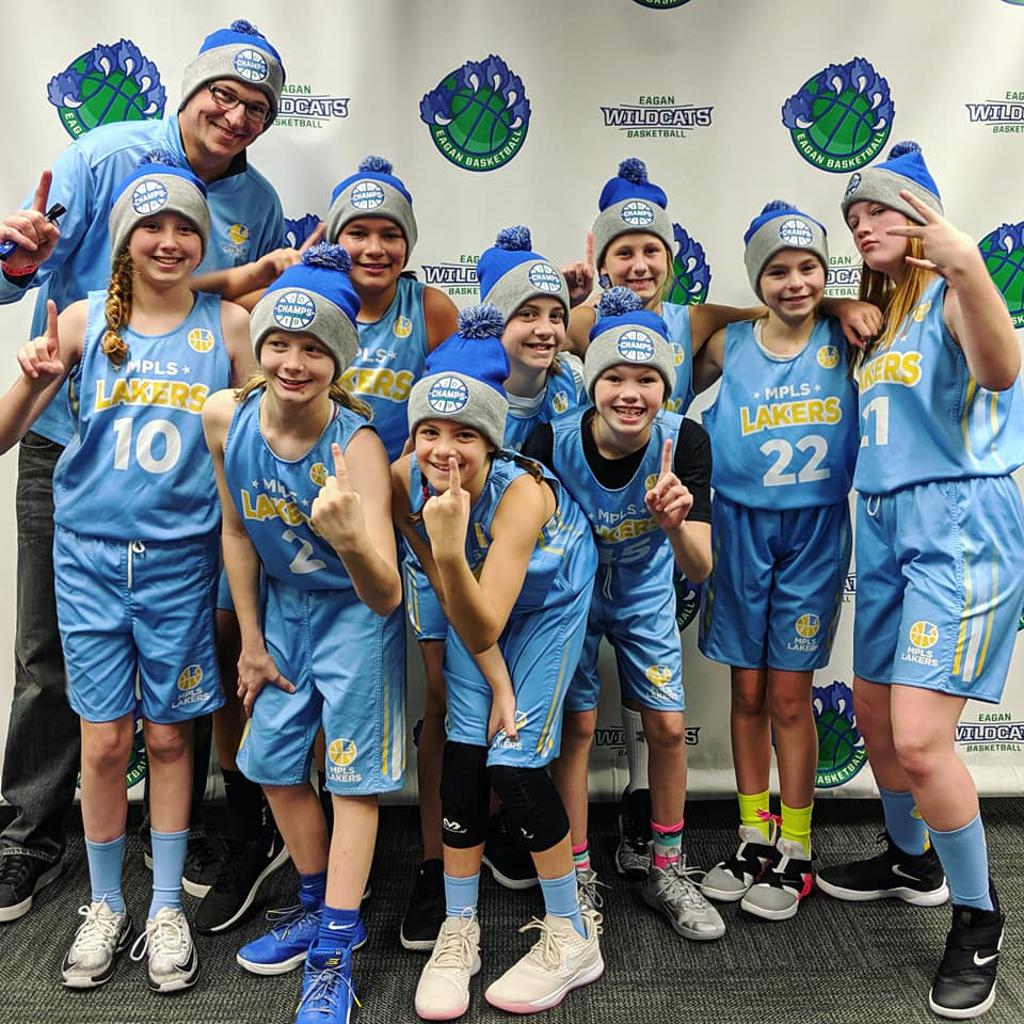 Minneapolis Lakers Girls 6th Grade Gold pose with their Hats after becoming the Champions at the Eagan tournament in Eagan, MN