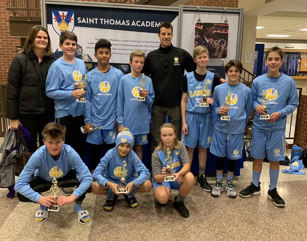 Boys 7th Grade Gold pose with their hardware after taking 2nd at Cadet Classic