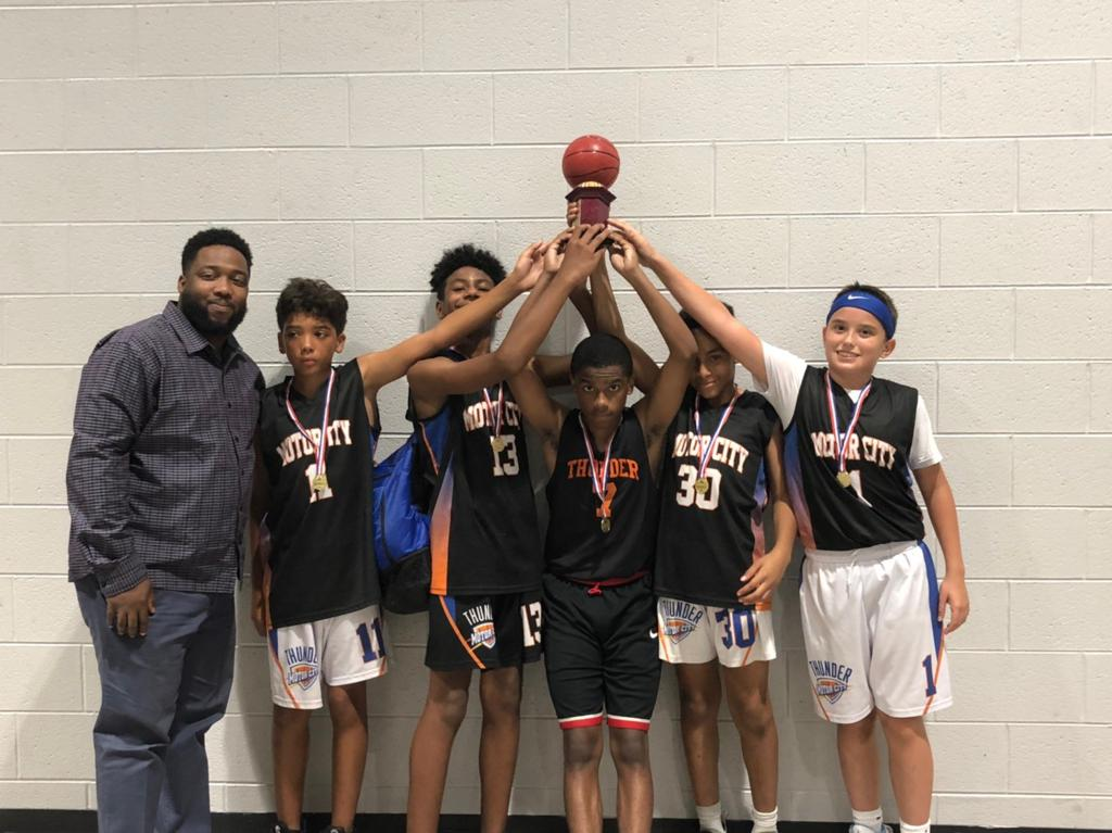 11U AAU Boys 2019 Spring/Summer League holding the 1st Place Trophy