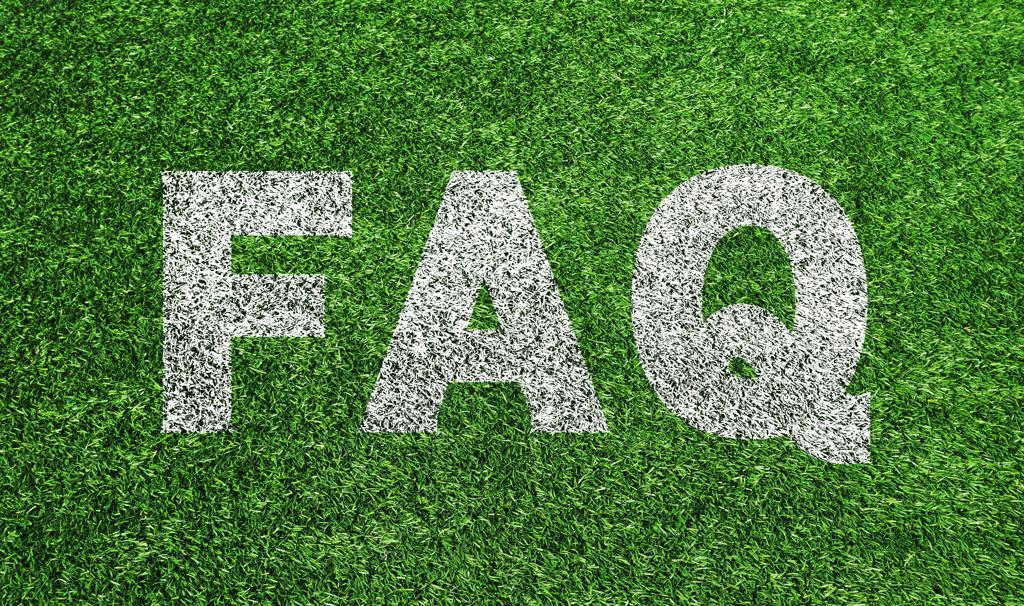 FAQ white letters written on green gras