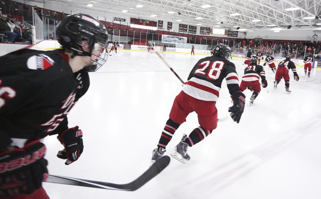 Duluth East takes to the ice for the 3rd period - Photo by Chris Juhn