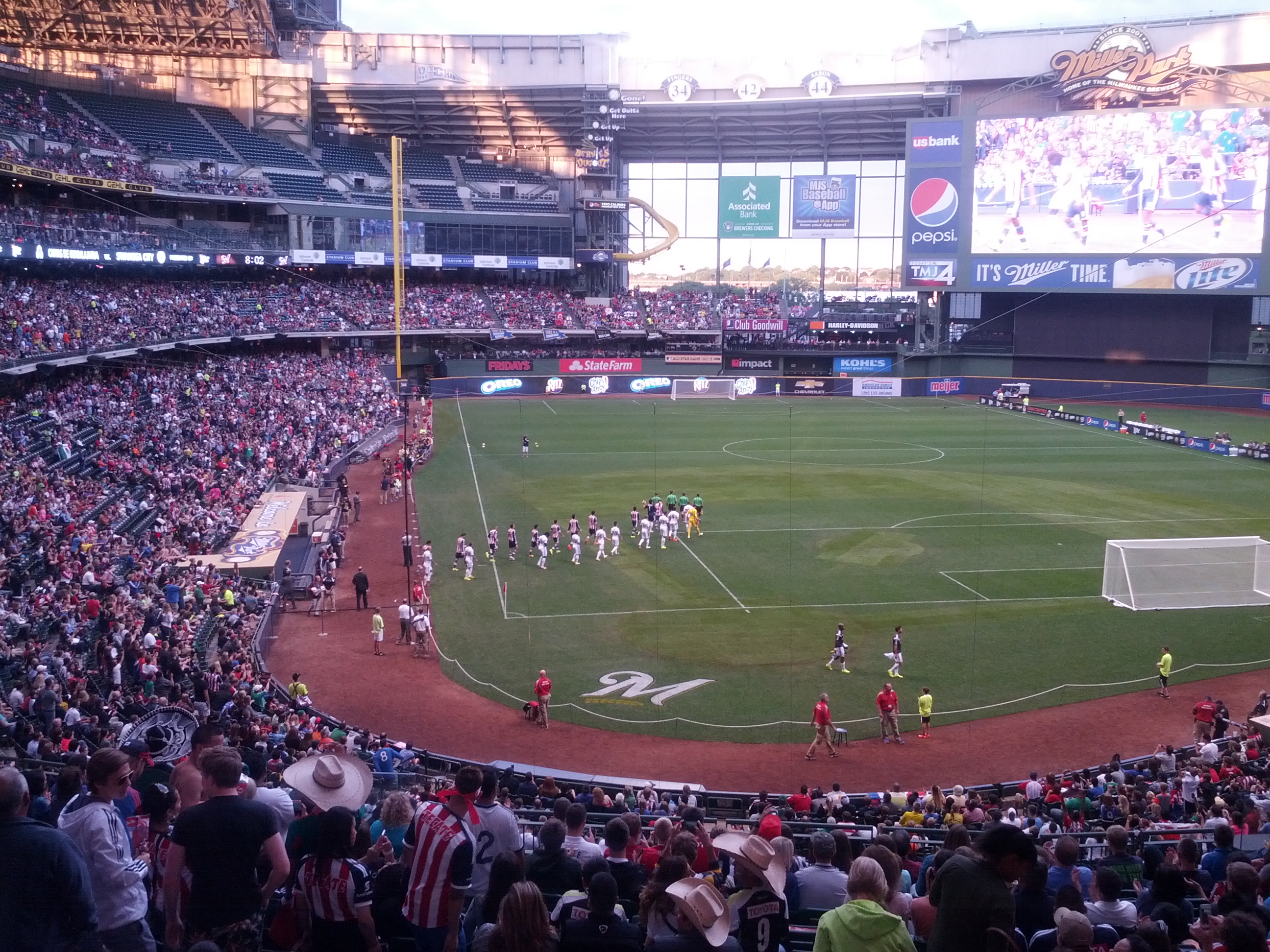 Chivas and Swansea City players take the field for the first soccer game at Miller Park in front of a crowd of 31,237.