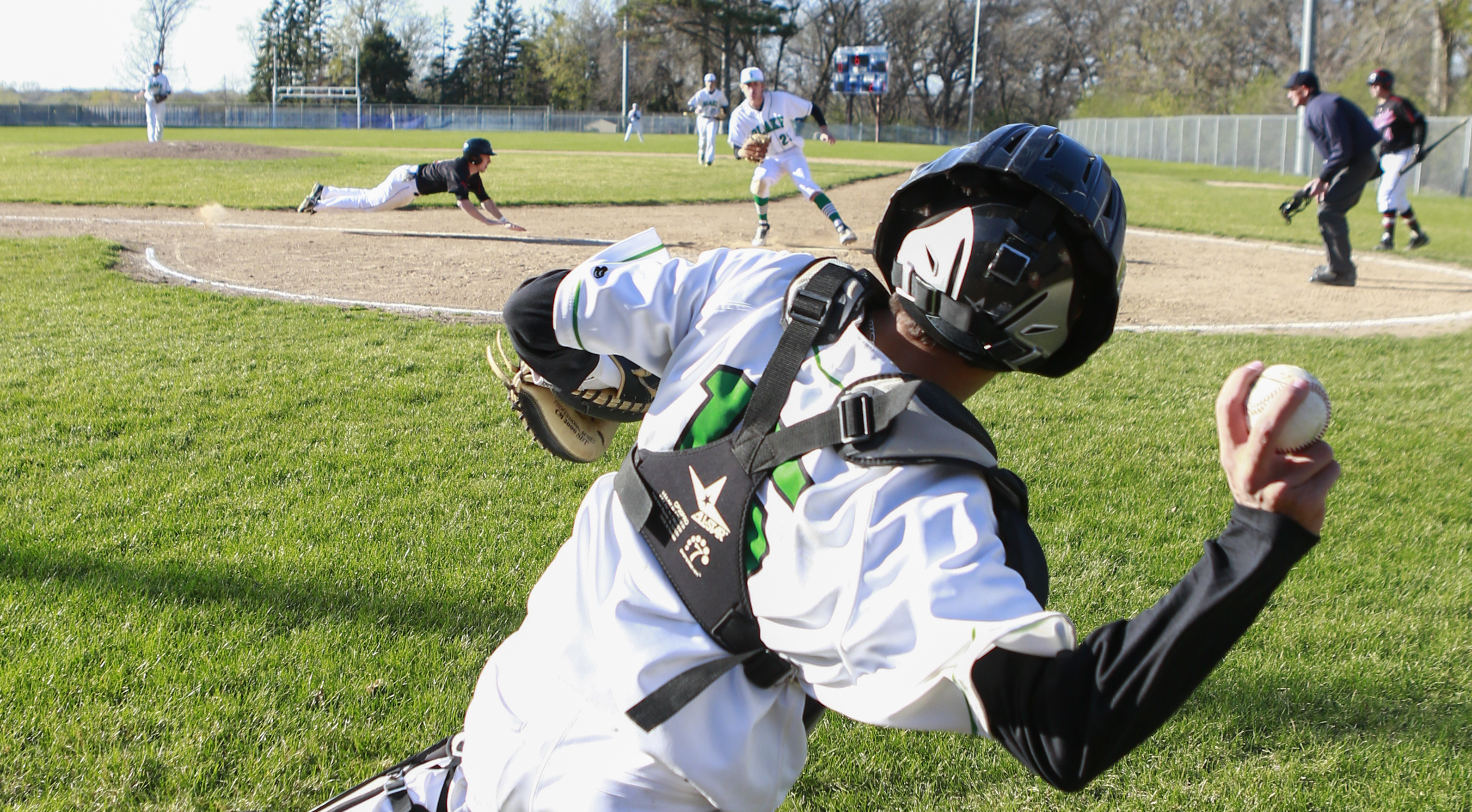 Ford Schroeder (3) of Minnehaha Academy slides in for a run in the 6th inning. Minnehaha Academy defeated Blake 5 to 1. Photo by Chris Juhn