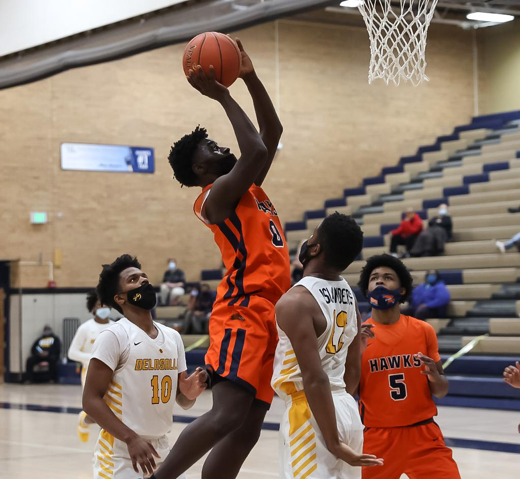 Junior guard Davion Evans (0) led scoring for the Hawks with 25 points and added five rebounds and three assists as No.4-4A Robbinsdale Cooper fell to No.8-3A DeLaSalle, 65-59. Photo by Cheryl A. Myers, Sports