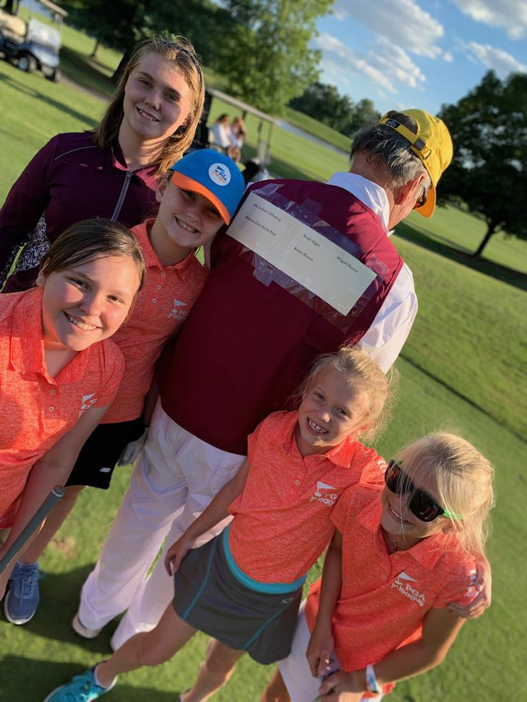 Eller even caddies for his granddaughter and her teammates!