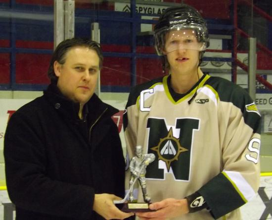 Randy Kleist presents Josh Peters with one of his awards