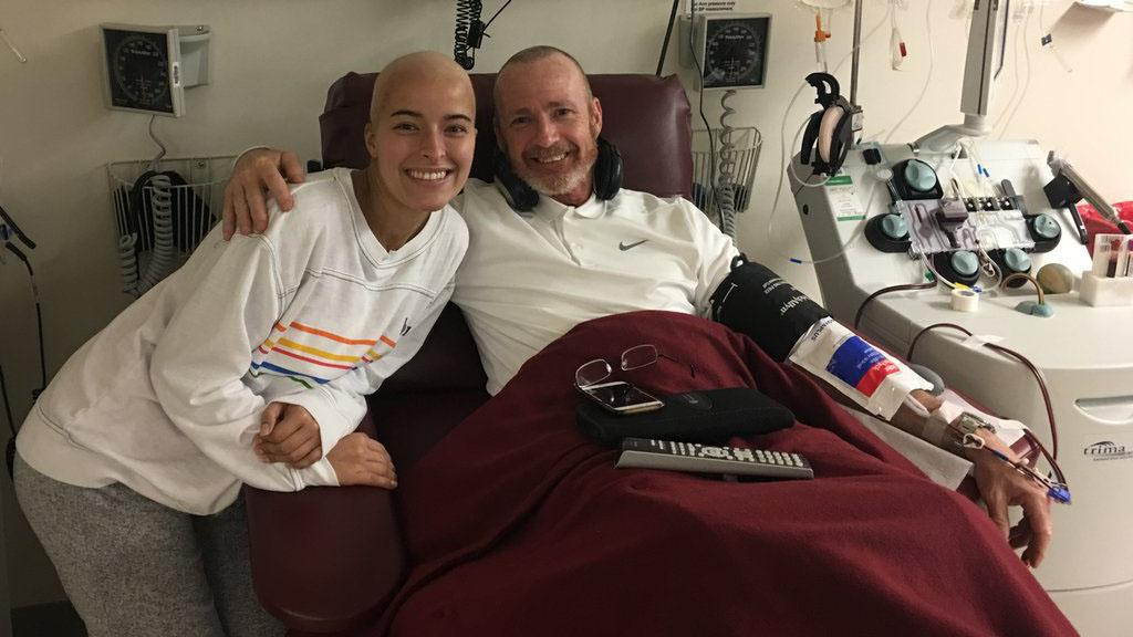 Memphis 901 FC Head Coach Tim Mulqueen donates platelets while being visited by former 901 FC intern Anna Della Rosa, who was recently diagnosed with Acute Myeloid Leukemia. | Photo courtesy Memphis 901 FC