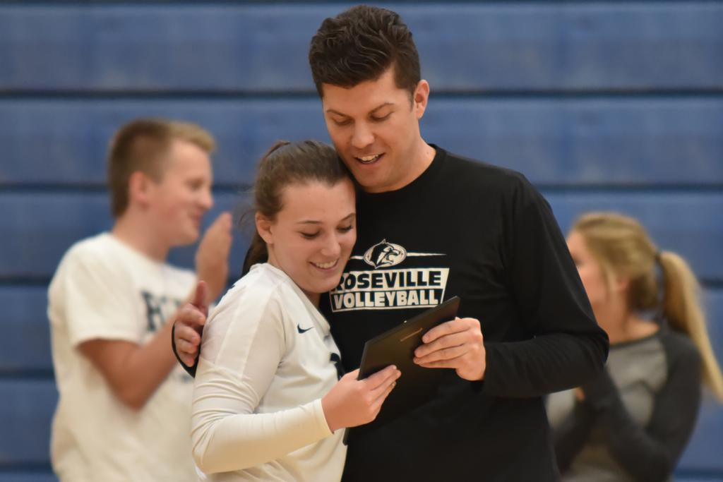 Haley Kauth is named Minnesota's All-Time Dig Record Holder for 2010-2015 and is congratulated by Coach Greg Ueland.  Photo by Kelly McGinley.