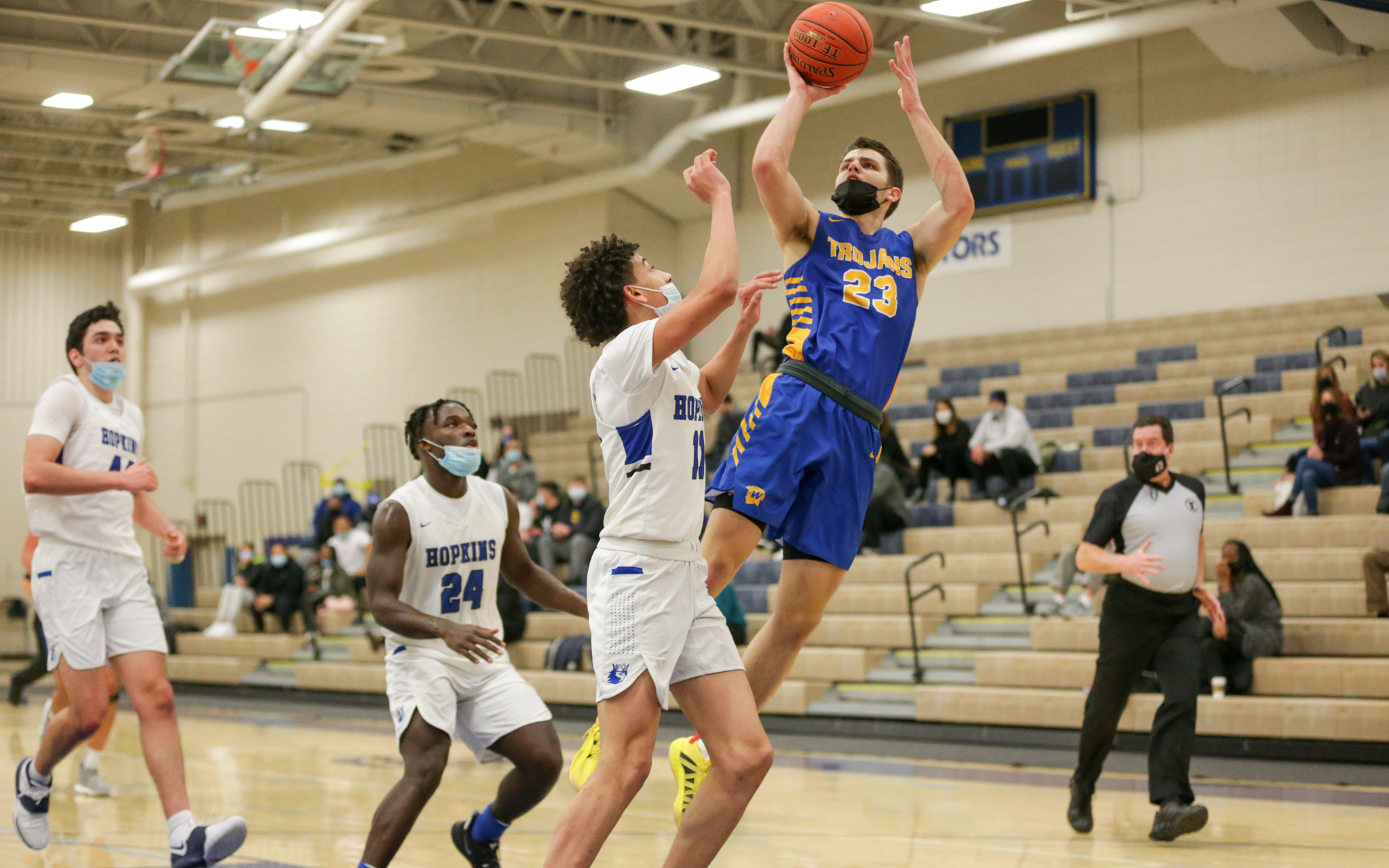 Wayzata's Camden Heide (23) puts up a jump shot against Hopkins Friday night. Heide had a game-high 24 points in the Trojans' 68-60 victory over the Royals in Wayzata. Photo by Jeff Lawler, SportsEngine