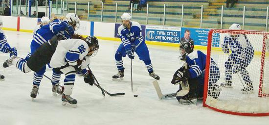 Minnetonka's Emma Bigham (No. 22) scores to take 1-0 lead against Hopkins in last year's 6AA semifinals. Minnetonka was the Class 2A State Tournament runner-up last season. Photo credit: YHH.