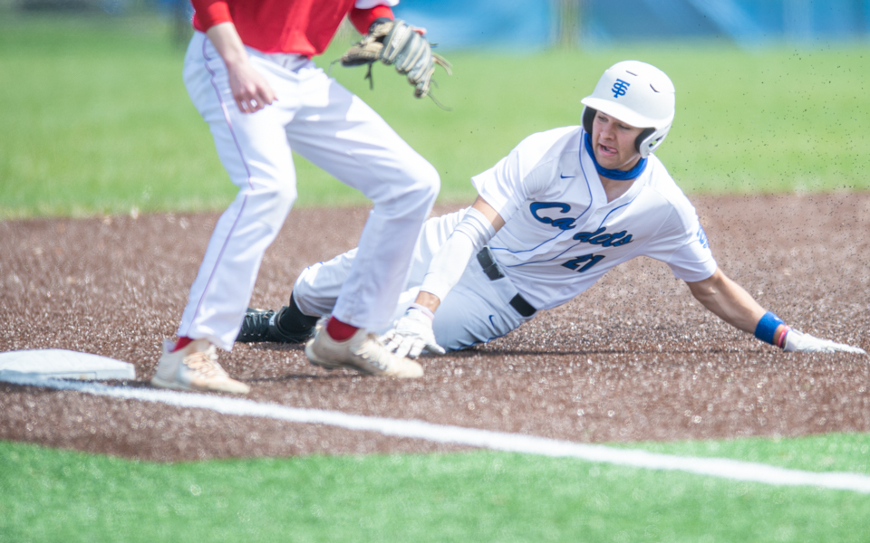 The Cadets' Angelo Pacyga slides safe into third base Saturday afternoon during St. Thomas Academy's 6-0 defeat of Benilde-St. Margaret's in a rematch of the 2019 Class 3A state title game. Photo by Earl J. Ebensteiner SportsEngine