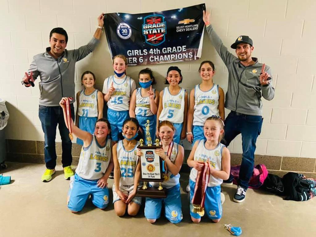 Mpls Lakers Youth Traveling Basketball Program Inc Girls 4th Grade Gold pose with their Trophies after becoming the Champions at MYAS Grade State year end tournament