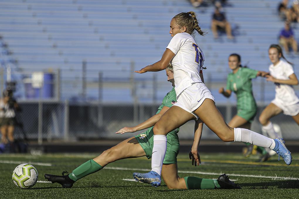 Wayzata's Abby Brantner (front) stopped a goal rush by Edina's Brooke Greeley. Photo by Mark Hvidsten, SportsEngine
