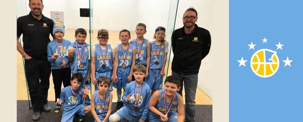 Minneapolis Lakers Boys 4th Grade Blue pose with their Medals after becoming the Champions at the Concordia Golden Bears Classic tournament in St Paul, MN