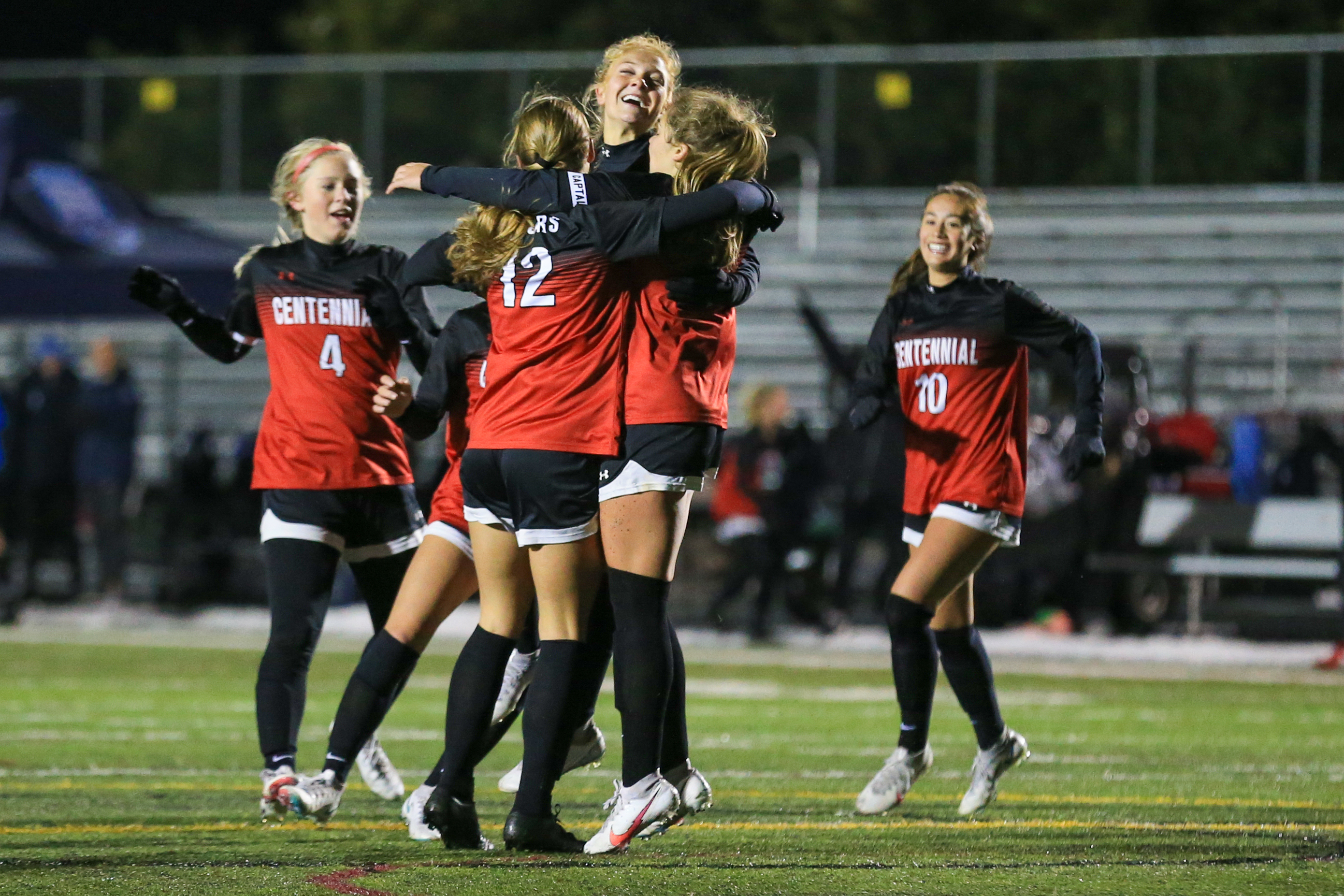 Centennial girls celebrate on the field in an Oct. 22 game against Blaine. Photo by Jeff Lawler, SportsEngine