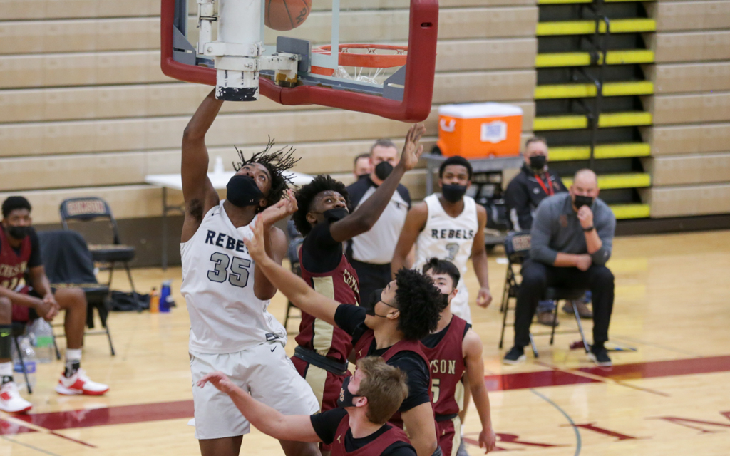 Champlin Park's Francis Nwaokorie (35) goes up for two of his 21 points against Maple Grove Friday night. The Rebels remained unbeaten on the season after a 57-50 victory over the Crimson in Maple Grove. Photo by Jeff Lawler, SportsEngine