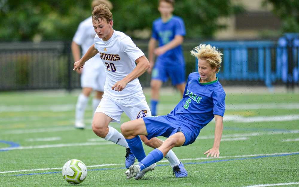 The Eagles' Daniel Brown takes the ball away from Blake's Matthew Carlson early in the second half. The Eagles lost to the Bears 4-0 Saturday afternoon in Hopkins. Photo by Earl J. Ebensteiner, SportsEngine