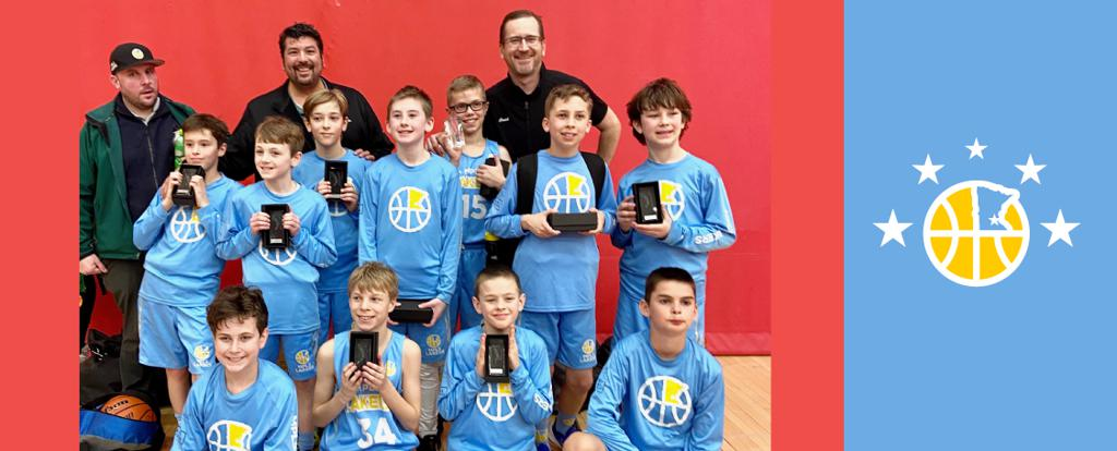 Mpls Lakers Youth Traveling Basketball Program Inc Boys 5th Grade White pose with their Trophies after becoming the Champions at the Stillwater Super Bowl Saturday tournament in Stillwater, MN