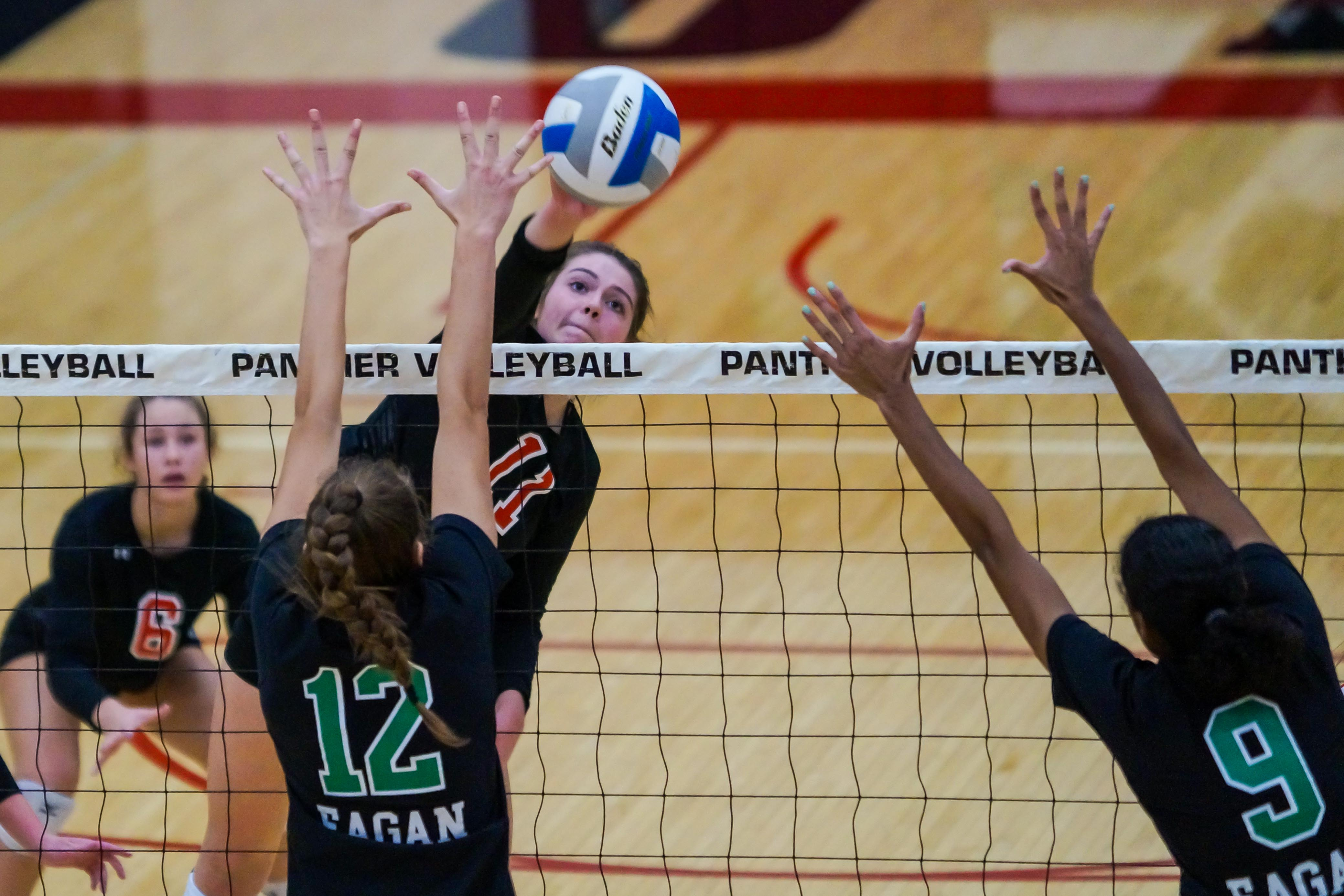 Lakeville senior Abbey Milner (11) with a spike attempt Thursday against Eagan. Milner had 15 kills, helping the Panthers to victory in their season finale. Photo by Korey McDermott, SportsEngine