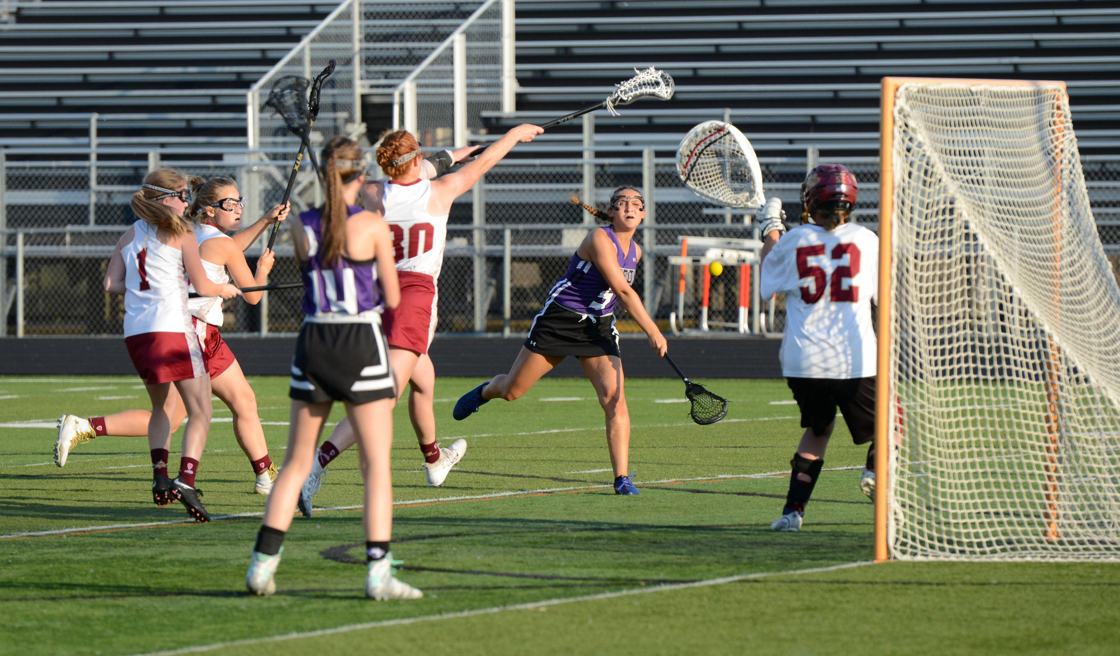 Buffalo midfielder Claire Stevens (5) shoots against Maple Grove in the Section 8 championship. Buffalo's late rally wasn't enough to stop Maple Grove. Photo by Carter Jones, SportsEngine