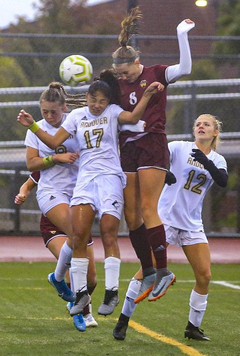 Maple Grove senior Abby Schulte (8) scores on a header early in the second half. The Crimson ended the Huskies' 12-game winning streak with a 2-0 home victory on Tuesday night. Photo by Cheryl A. Myers, SportsEngine