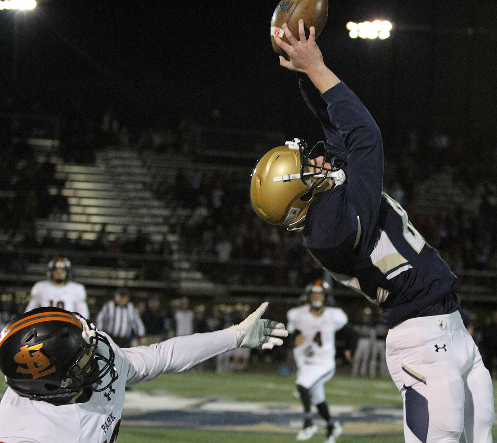 Chanhassen sophomore wideout Charlie Coenen hauls in a pass near the sideline to set up the Storm's second touchdown Friday night. Photo by Drew Herron, SportsEngine