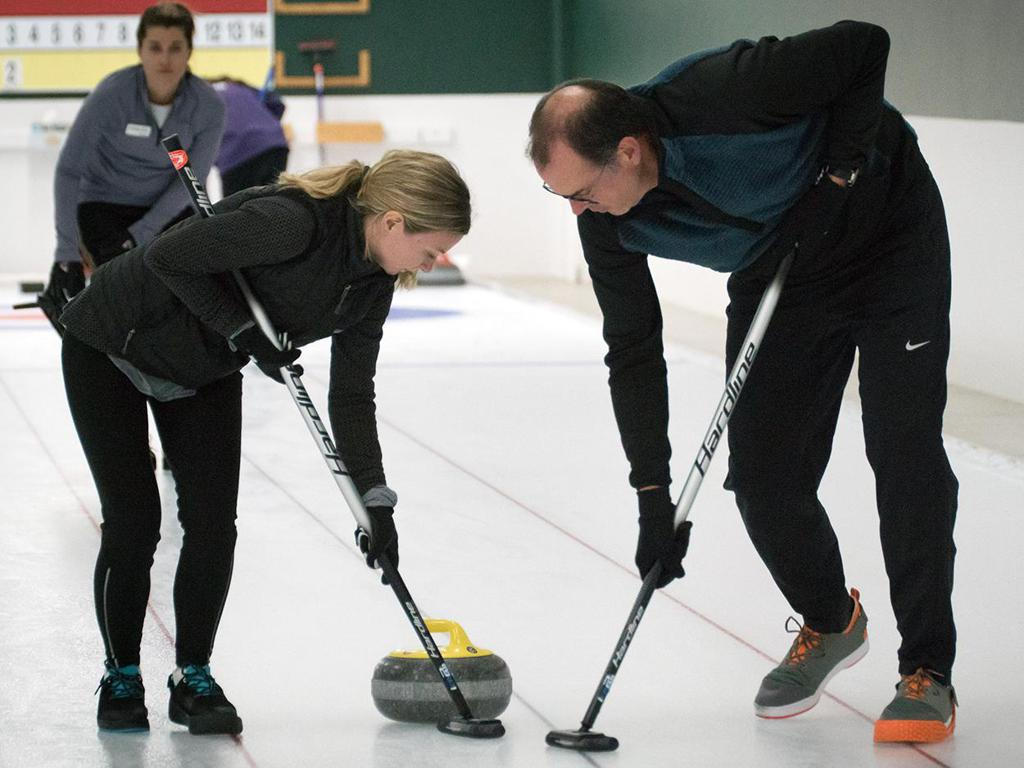 Mixed curling sweepers with stone