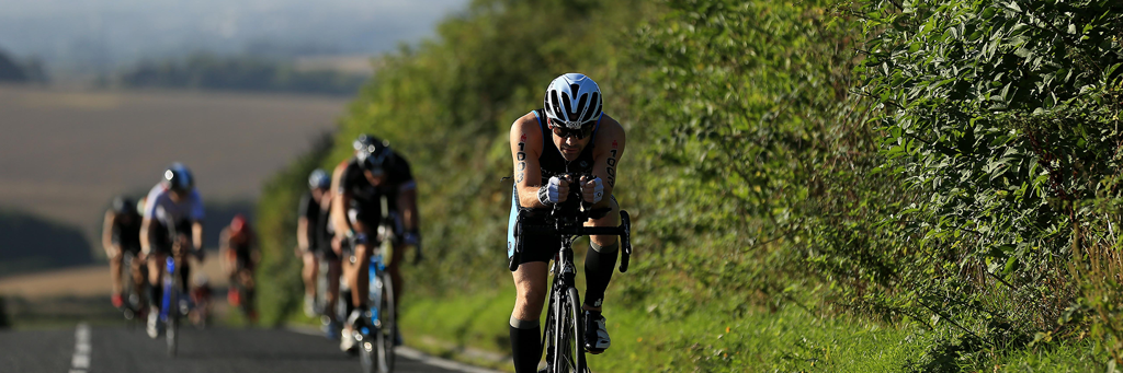 IRONMAN 70.3 Weymouth athletes biking in a row through the rolling Dorset countryside