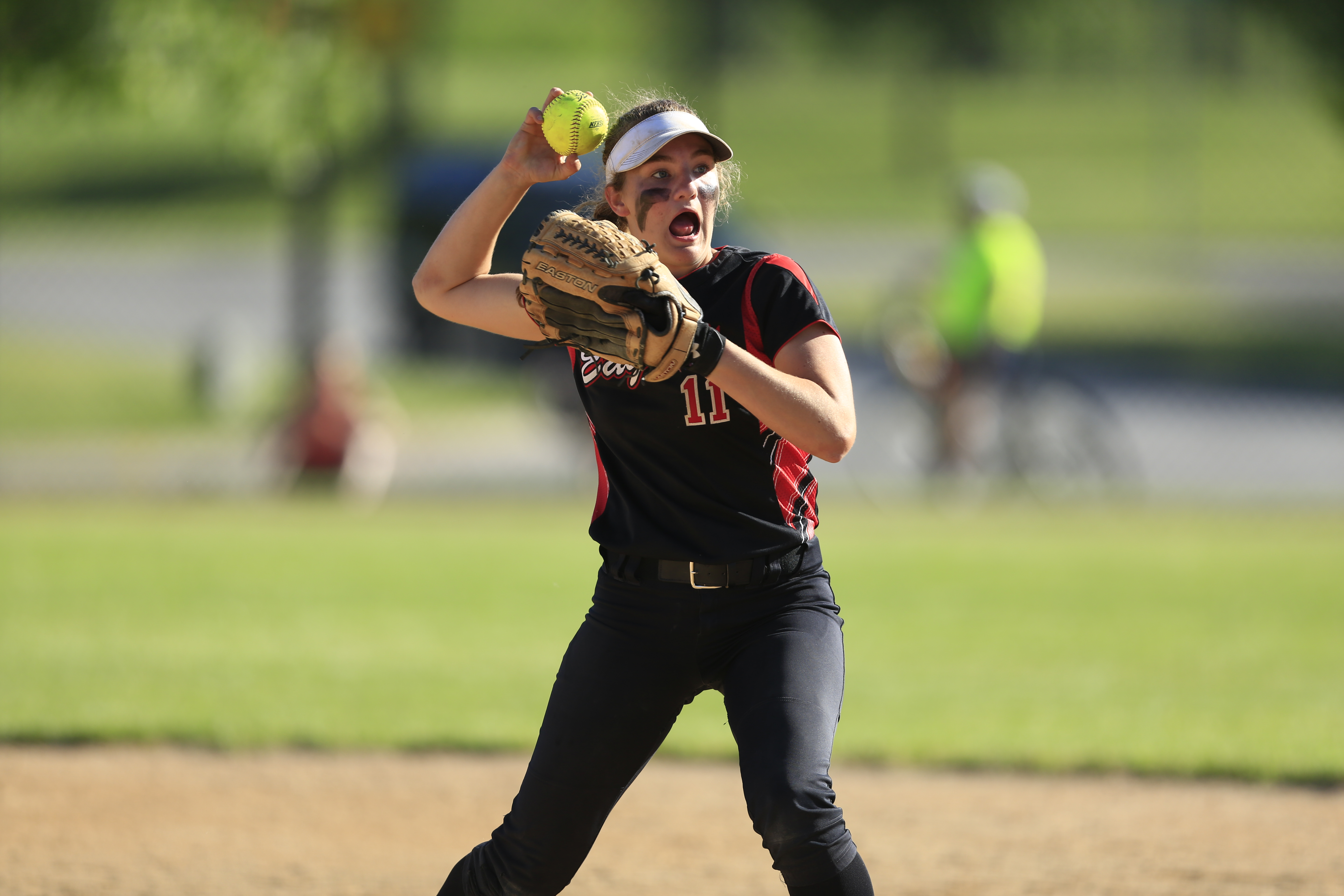 The Eden Prarie Eagle's 2nd basemen, Sydney Shields (11) throws the ball to first base in an attempt to get an out. Eden Prairie lost 3-6 at home. Photo by Chris Juhn