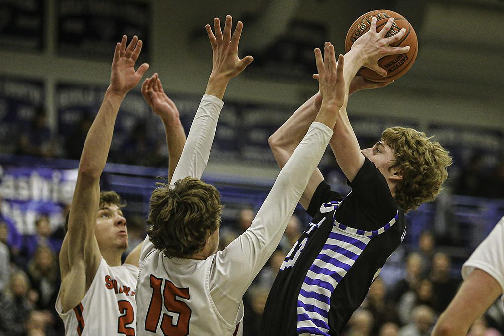 Eastview's Steven Crowl, right, put up a shot over Shakopee defenders Charlie Katona, left, and Nick Katona. Crowl scored 26 points in Eastview's 82-69 victory. Photo by Mark Hvidsten, SportsEngine