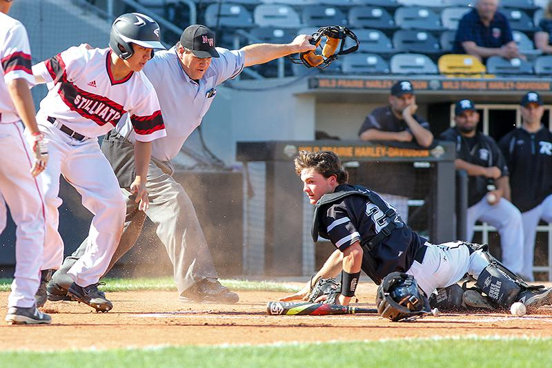 Stillwater's Tuanson DuFresne-To, right, popped to his feet after beating the tag at home plate and scoring one of the Ponies' six first-inning runs. Photo by Mark Hvidsten, SportsEngine